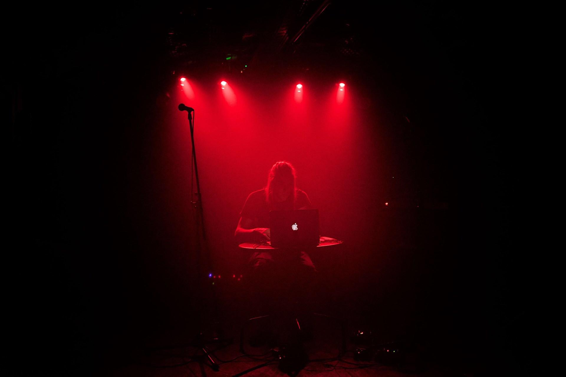 Power Therapy live by Áron Macsicza. Dark red stage, taken in Bratislava.