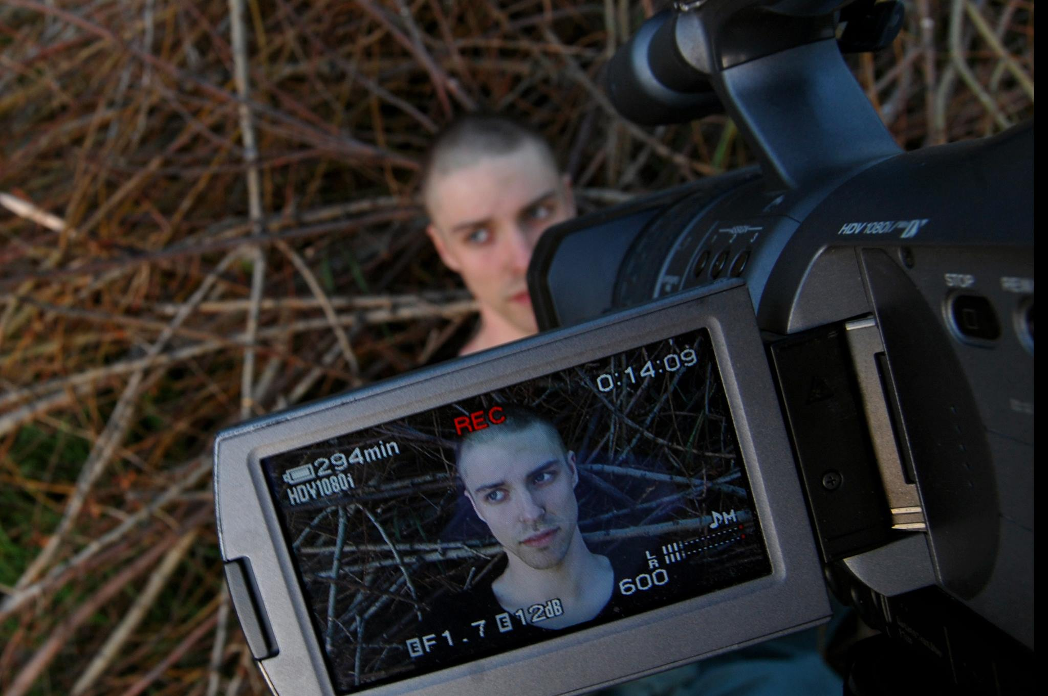 An image of the viewfinder of a digital video camera filming the face of Jonathan Fox.