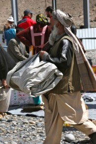"""An Afghanistani man carries his """"shop"""" in the bazaar. Photo: Helen"""