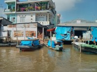Mekong boat tour - clear day riverside town
