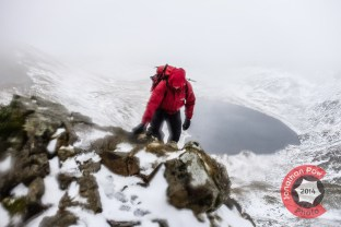Graham climbing with Red Tarn behind
