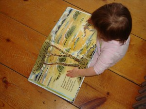 """Julia """"Reading"""" a Book of Children's Poems"""