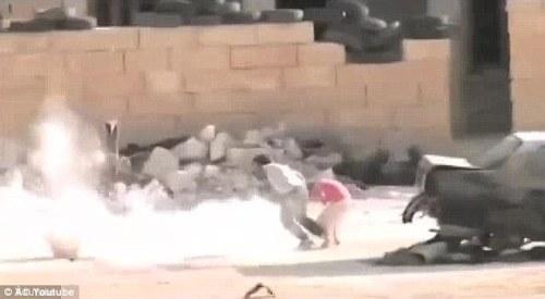 1416045268537_wps_30_Syrian_boy_hero_2_jpg