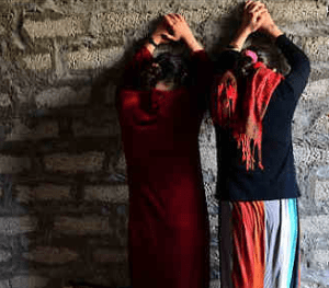yazidi-women-facing-wall