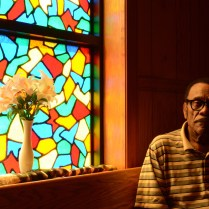 Bishop Isaac Jenkins Sr. of Macedonia Baptist Church in Pocomoke City sits in the choir room of his church. Growing up in Portsmouth, Virginia, he was the only one of S.M. Jenkins' seven children who wanted to follow in his father's footsteps and become a pastor.