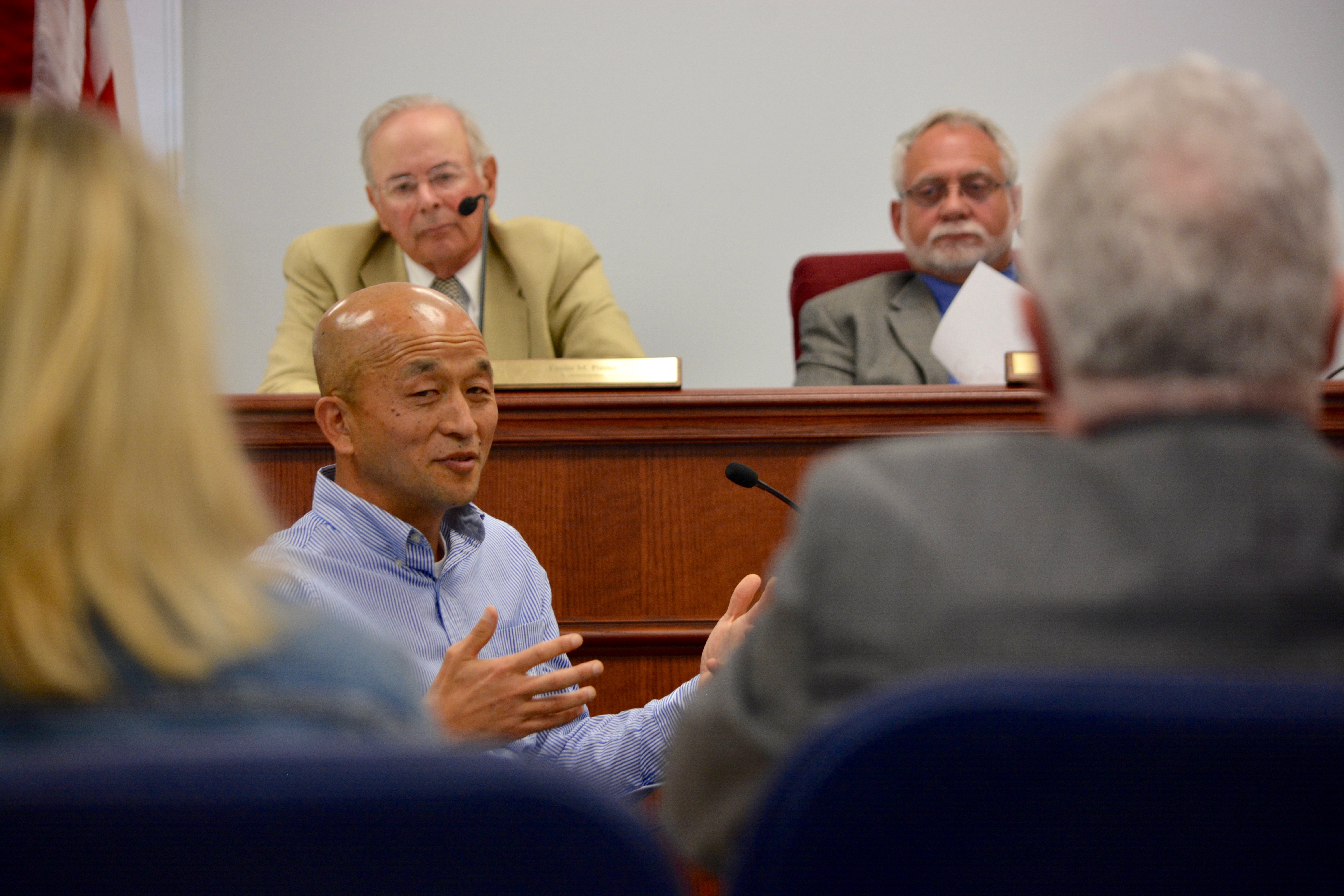 Steve Kim delivers testimony to the Baltimore County Liquor Board as it hears his application for a liquor license Monday, May 1. The license was denied.