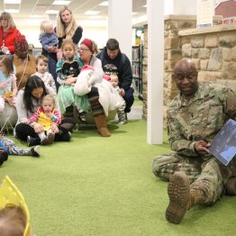 "APG Senior Commander and CECOM Commanding General Maj. Gen. Mitchell Kilgo reads ""The Lion and the Mouse,"" by Jenny Broom, to local children during the fourth annual Fairy Tale & Superhero Festival at the Bel Air branch of the Harford County Public Library Friday, Jan. 17, 2020. The event is held as a celebration of all things reading."