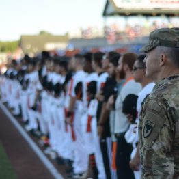 Aberdeen Proving Ground Senior Commander Maj. Gen. Randy Taylor stands with the Aberdeen Ironbirds during a performance of the national anthem at Ripken Stadium June 14, 2018