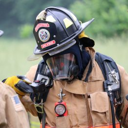 A firefighter from the APG Fire Department prepared to take part in a controlled burn exercise at the Welzenbach Farm in Edgewood Saturday, June 2, 2018.