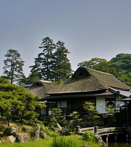 He lives in an old house on the grounds of his shrine, with plaster walls, a thatched roof...