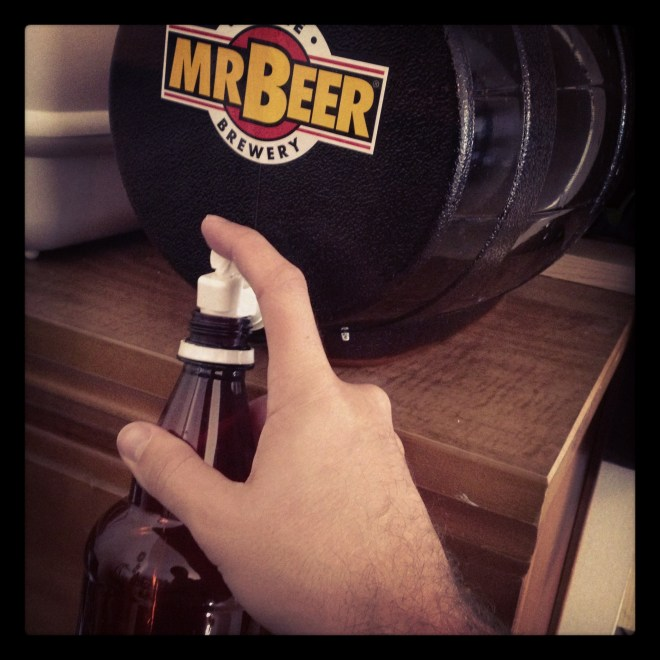 Filling bottles of home brew from Mr. Beer keg