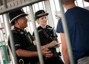 Police officers with British Rail passengers at a railway station