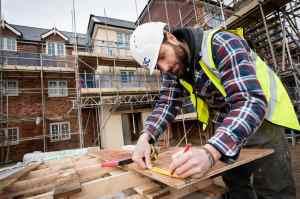 Carpenter workin on a building site