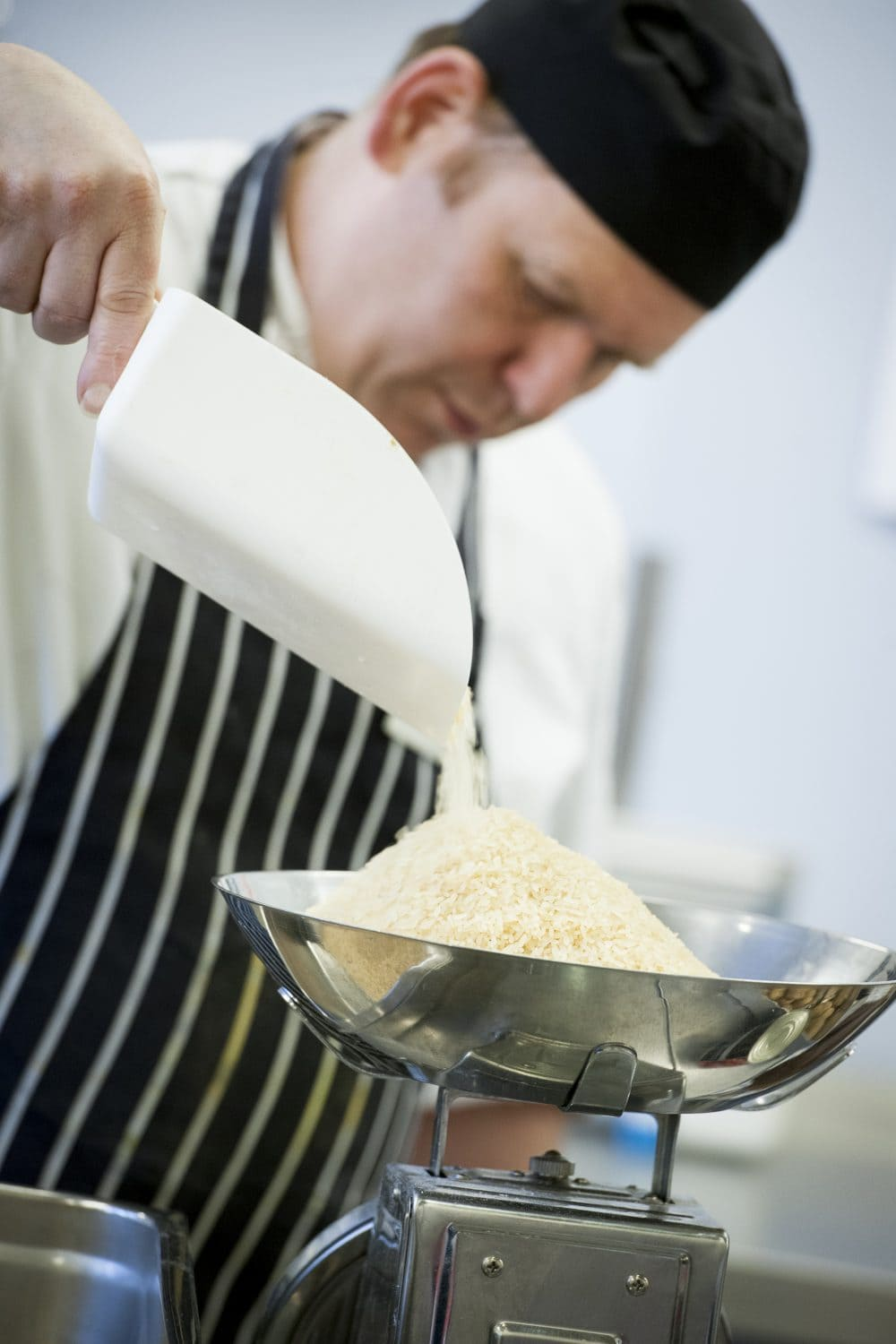 Sodexo Chef weighing rice