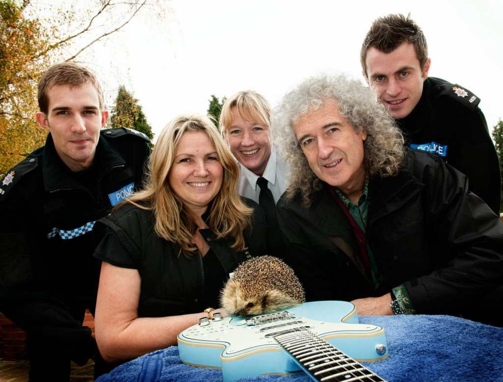 Police officers with rescued hedgehog and Brian May