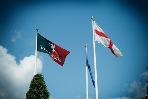 Flags Flying at Wentworth against a blue sky