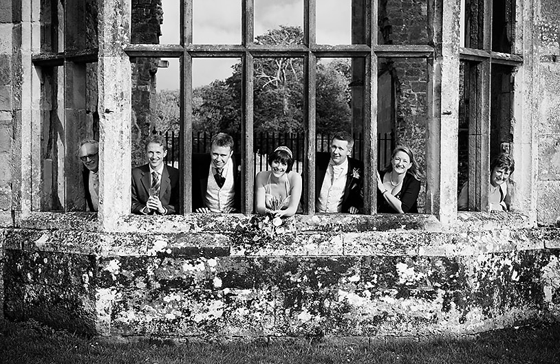 fun wedding group in the ruins, sussex wedding photography