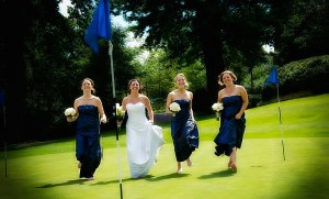 Bride running across a golf green