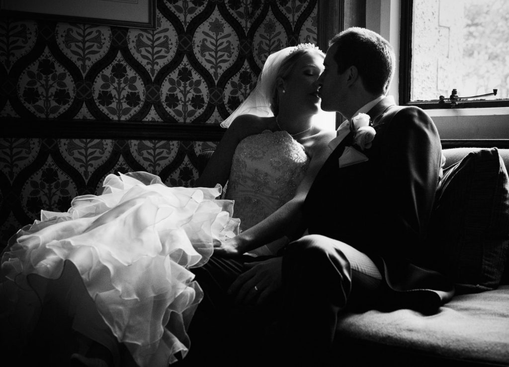 Silhouetted Newly Weds at Frimley Hall Hotel. Intimate moment between a bride and groom