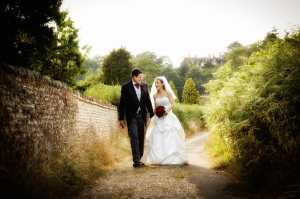Bride and Groom walking along a country lane in Frensham