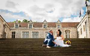 Wedding coupleon the steps at The Great Hall, Winchester
