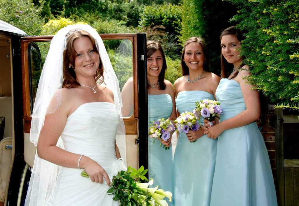 Bride and Bridesmaids by the wedding car at Hambledon, Godalming