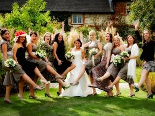 Girls having fun at a wedding at Bury Court