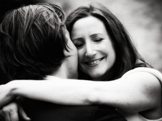 Couple hugging at The Great Barn in Tetbury