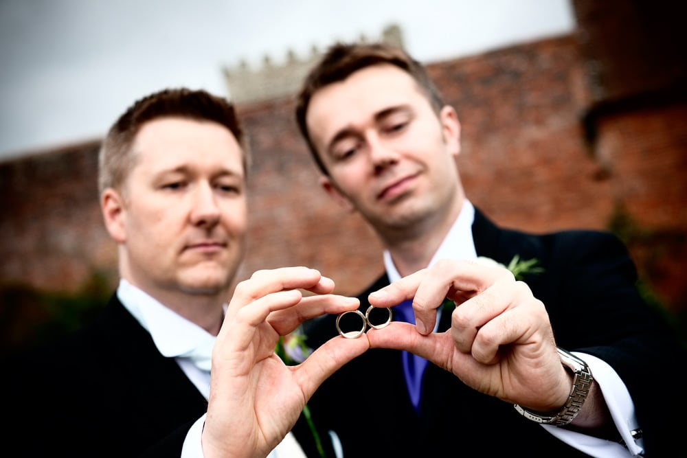 Best manand Groom with wedding rings, Cowdray Park wedding photographer