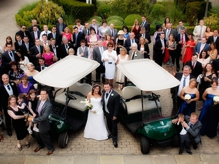 Large Wedding group at Wentworth Club with golf buggies