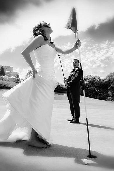 Fun wedding photography, groom misses the hole at Wentworth
