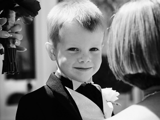cute page boy, black and white wedding photography