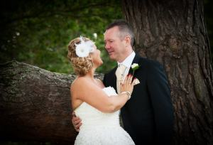 Bride and groom by an oak tree