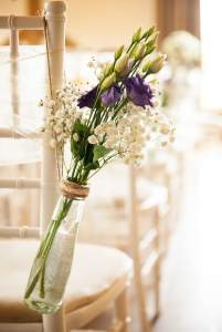 Wedding flowers in the aisle