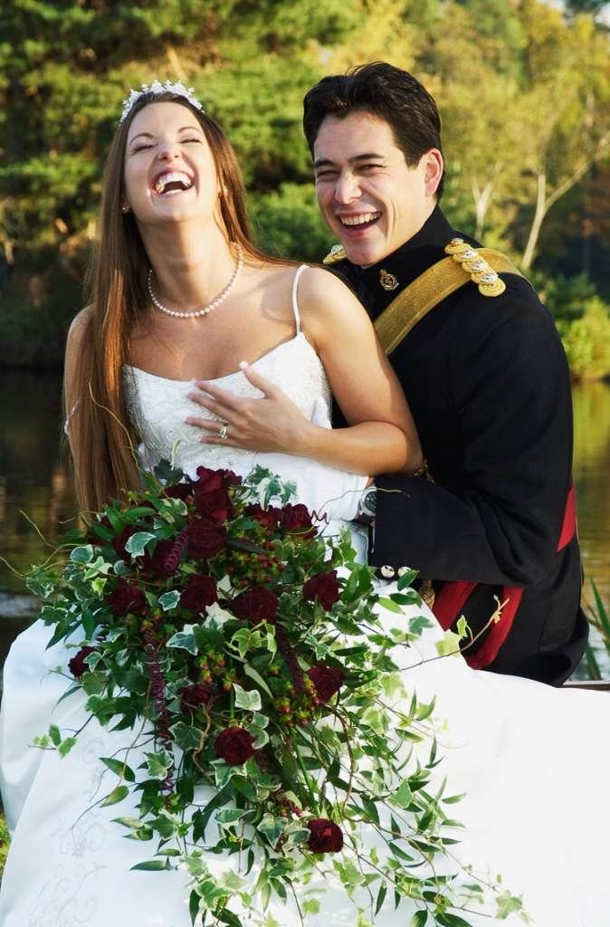 Army officer laughing with his bride