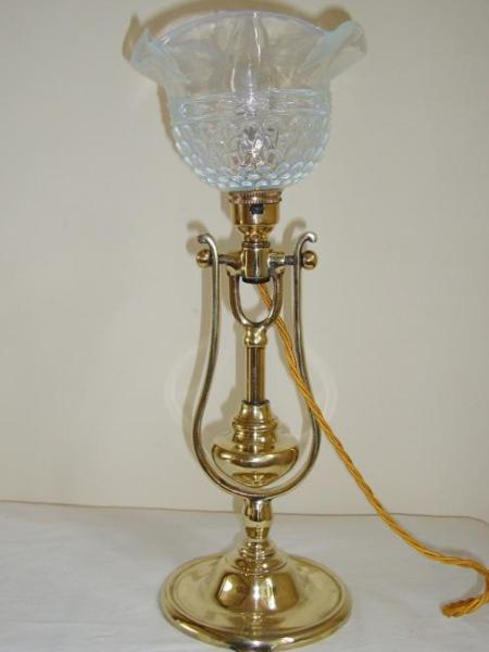 "A pair of English cast-brass ""gimbal"" table lamps, C1910"