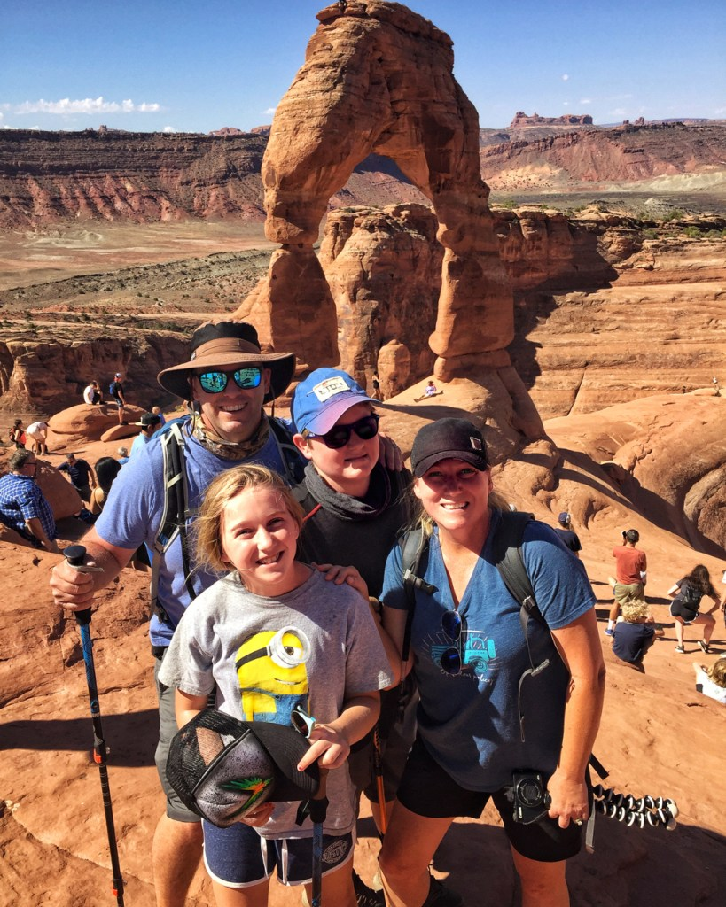 family picture at delicate arch
