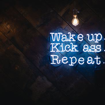 light sign saying wake up kick ass repeat