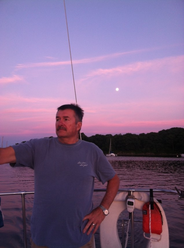 Ken sailing with the moon guiding him