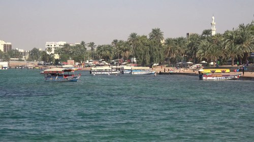 tourist-boats-wait-for-customers-at-the-popular-beach-of-aqaba-in-jordan_s8oiotqie_thumbnail-full01