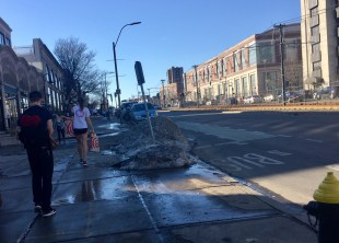 Instead of taking taxis or the BU Shuttle, students chose to walk to spots like Target in clothing like shorts, as pictured, even though piles of snow from the previous blizzard still remain. Photo by Jordana Kulak