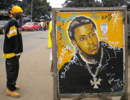 6.- These barbershop signs of men from throughout the African diaspora offer images of likeness for men on Abidjan's periphery.