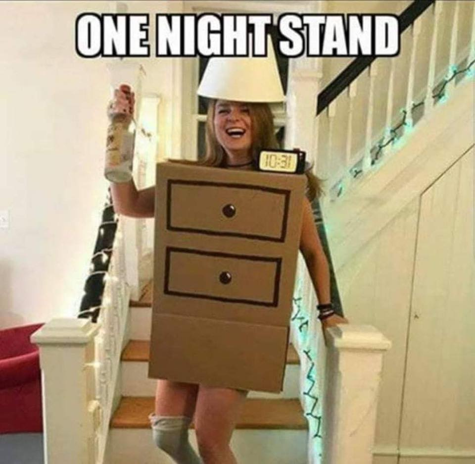 A woman with a cardboard cutout of a chest of drawers with a lampshade on her head