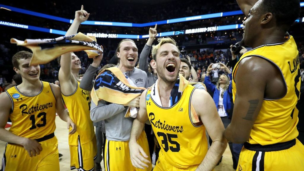 Five UMBC players celebrate their upset win over Virginia in the 2018 NCAA men's basketball tournament