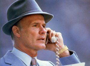 Photo of former Dallas Cowboys head coach Tom Landry in his trademark gray felt hat