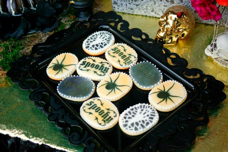 Halloween sugar cookies by Desert Flours Bakery for a sophisticated black and gold Halloween dinner party