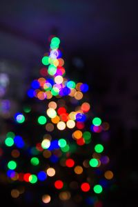 Blurred christmas tree with lights. If you and you spouse are struggling to be close, then consider starting online couples counseling in texas or online couples counseling for indiana. Jordan Therapy Services wants to help you feel connected again.