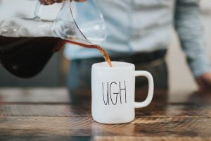 Person pouring coffee in to a white cup with 'ugh' written on it. If you're tired of waiting and want anxiety to subside. Try started online therapy in texas or online therapy in indiana today for more relief. Jordan Therapy Services can help
