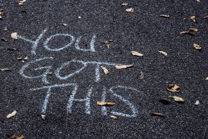 Writing on asphalt saying 'you got this'. If you're are waiting to hear better news about infertility, maybe focusing on your maternal mental health and starting therapy for infertility can help you. Email me today!