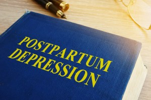 Book with postpartum depress written on cover.Find postpartum depression in texas or postpartum support in indiana. We are here to support our clients with postpartum support in texas. Postpartum depression in indiana doesn't need to take over your voice. Get in touch with Jordan Therapy Services